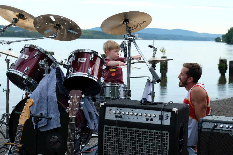 While the band was on a break, Max Danger tried his hand on the drums as dad Anthony Defraia looks on.