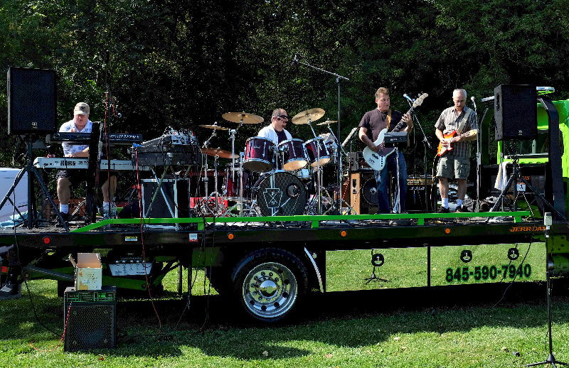 The band A Touch of Rhythm performed classic rock at the festival.