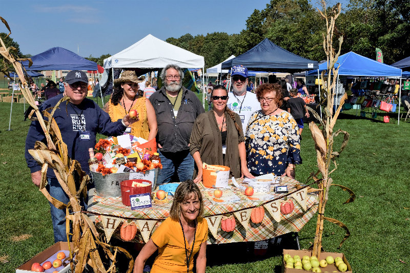 The Highland Business Association hosted the Highland Harvest Festival. Pictured is the Board of Directors: L-R Howie Schwartz, President Renae Martin, Rob Forrest, Treasurer Barbara Marshall, Sal Sorbello and VP Dolly Decker. Kneeling is Secretary Bonnie Napier.