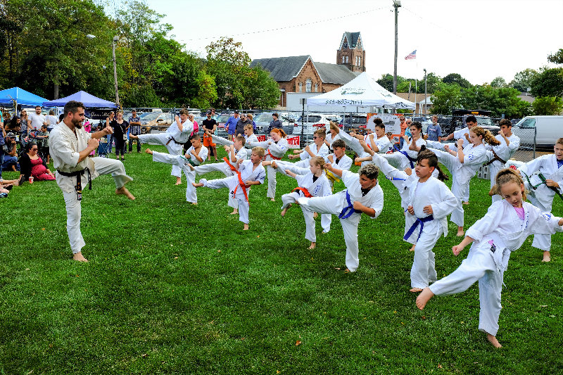 Sensei Daniel Paradies, Assistant Chief Instructor of Bushiken Karate, has his students show off their leg kicks.