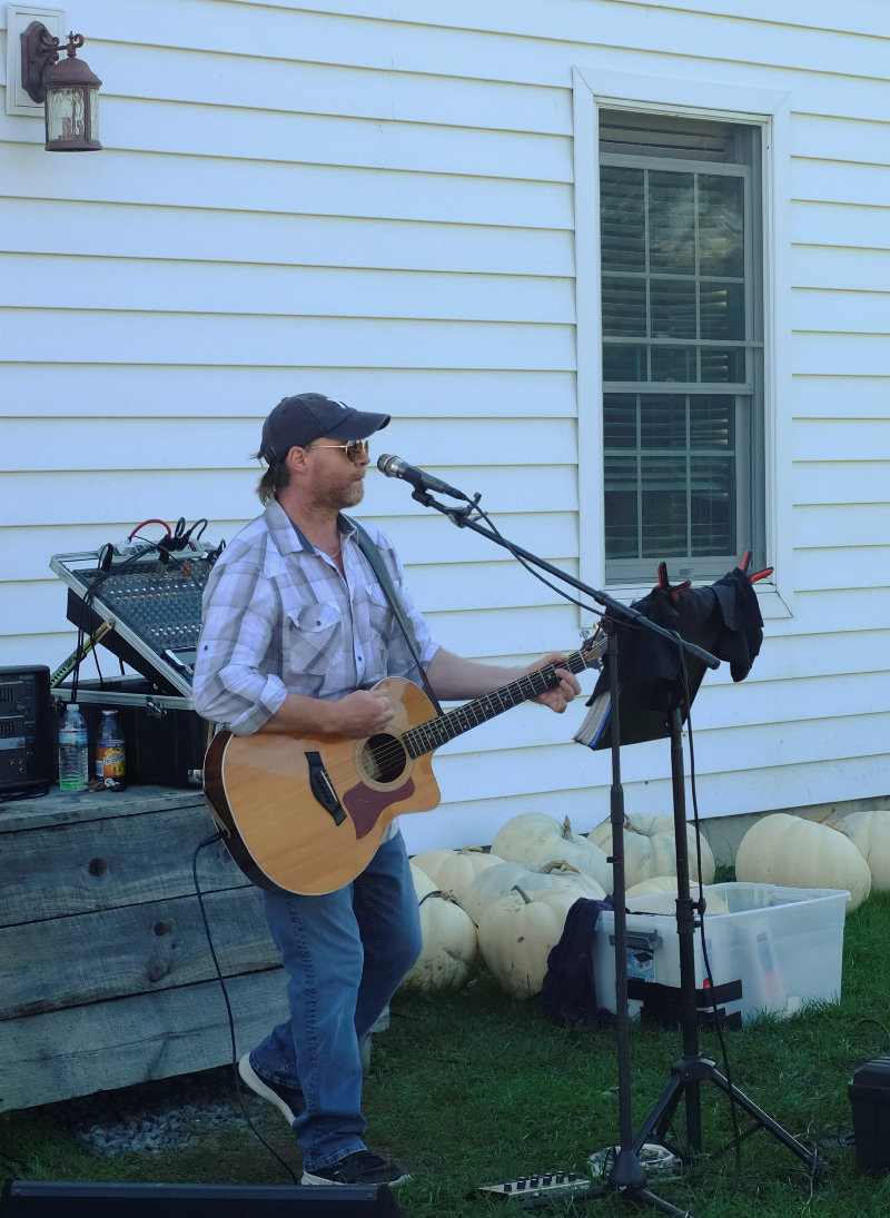 Musician James Patrick Cunningham provided acoustic music all afternoon at DuBois Farm.