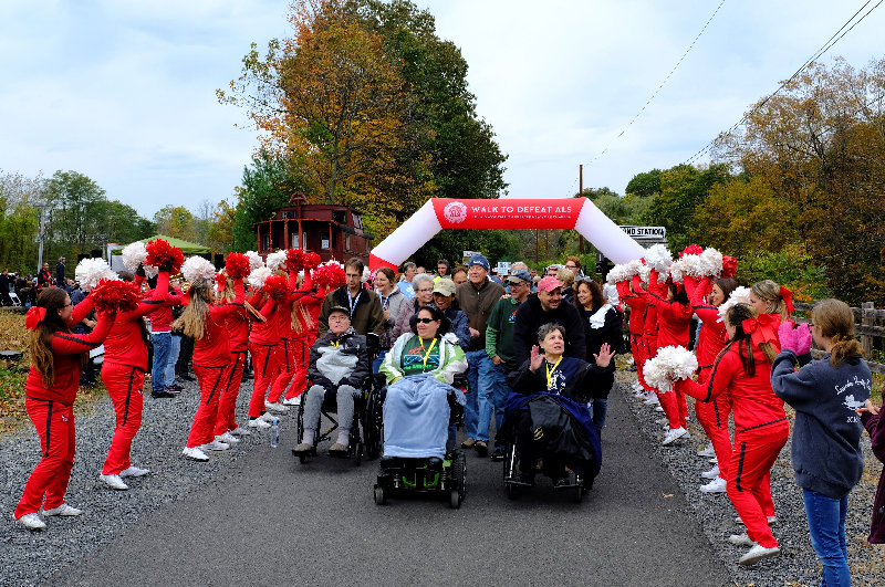 The Marist College Cheerleaders spurred on those in wheel chairs and the walkers who followed.