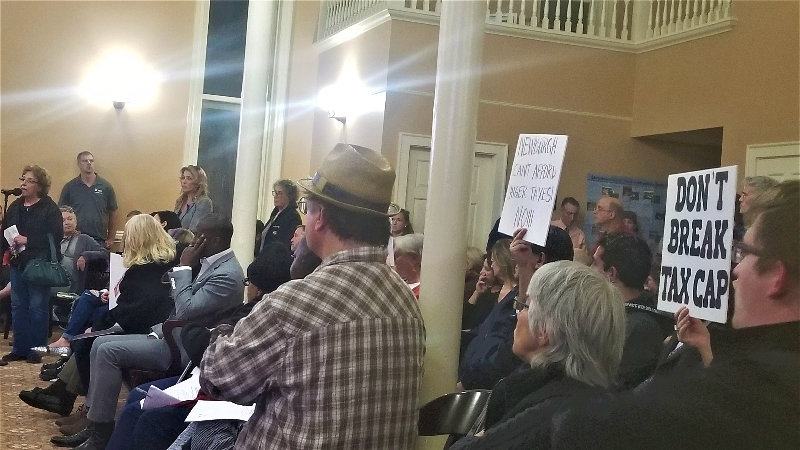 City Hall was packed Monday night with residents concerned over rising taxes.