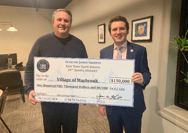 Maybrook Mayor Dennis Leahy (l.) accepts a $150,000 check from State Senator James Skoufis.