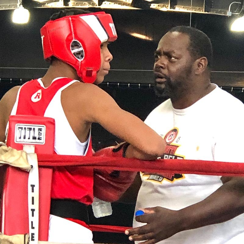 Newburgh Hook Elite boxer Zyrell Williams with Coach Leonard Lee during his semi-final match Saturday.