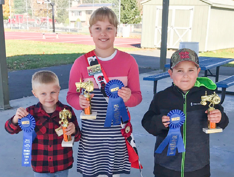 The winners for the pedal tractor pull. From left to right: Silas Wieboldt, Hannah Wieboldt and Wyatt Wilson.