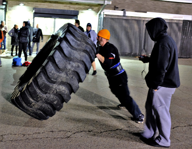 Ben Lambousis flipped a 700 pound construction tire 113 times in an hour to raise money for suicide awareness and prevention at the Marlboro High School last week.