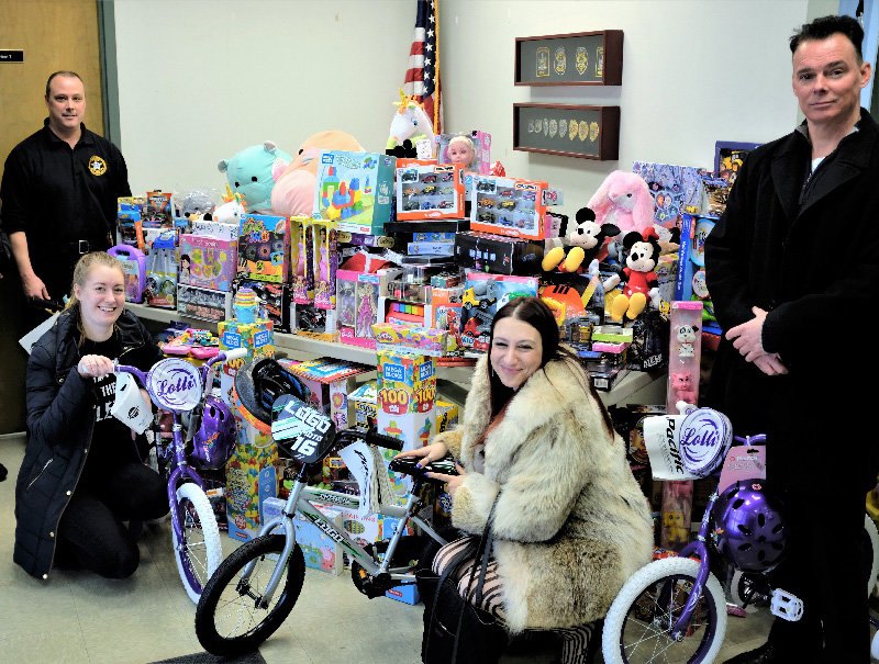 The Lloyd Police shared the toys they collected with representatives of the Grace Smith House and the local children in Highland. Pictured L-R Lt. James Janso, Simone Berry, Youth Advocate, Nina Schutzman, Community Development Coordinator and Chief Daniel Waage.