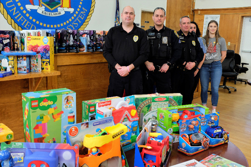 The Marlborough Police Department distributed a roomful of toys to families in need. Pictured L-R Chief Gerald Cocozza, Sgt. Mike Sotanski, Sgt. Chris Griggs, dispatcher Jennifer Van Amburgh and Georgie Super.
