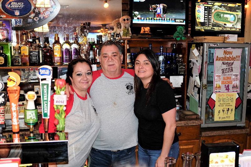 Sal Timperio marked the 40th anniversary of his landmark restaurant/bar, simply called Sal's Place in Highland. He is flanked by his daughter Alisha Timperio (L) and his niece Natasha Gasparro.