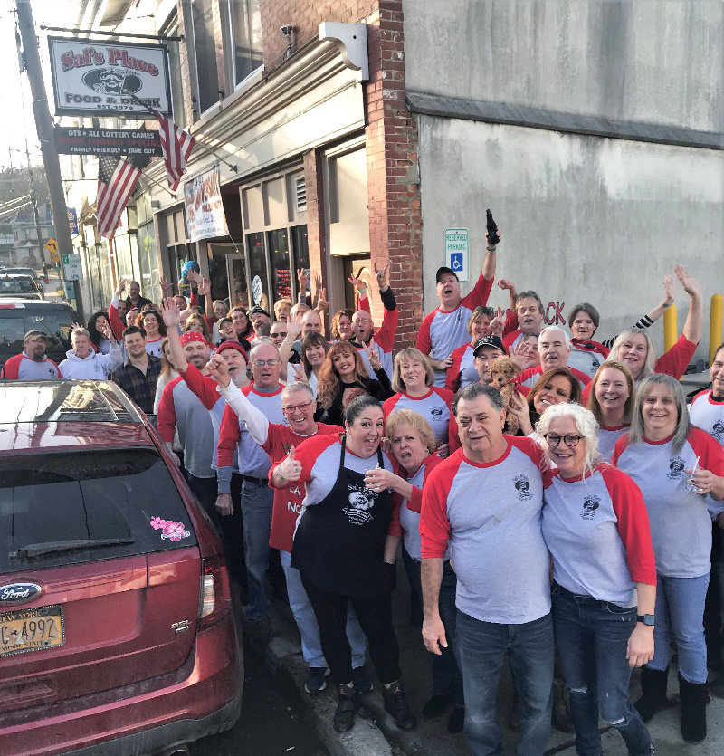 Sal Timperio celebrated the 40th anniversary of his Highland establishment on Saturday with a party. Friends spilled out onto the street for a group photo, with Sal at the center of it all.