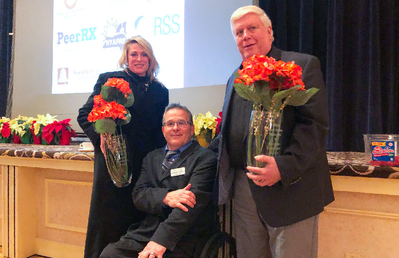 Doug Hovey, (c) President and Chief Executive Officer of Independent Living, with   Darcie Miller, (l), Orange County Commissioner of  Social Services and retired Commissioner of Health, Chris Ashman.