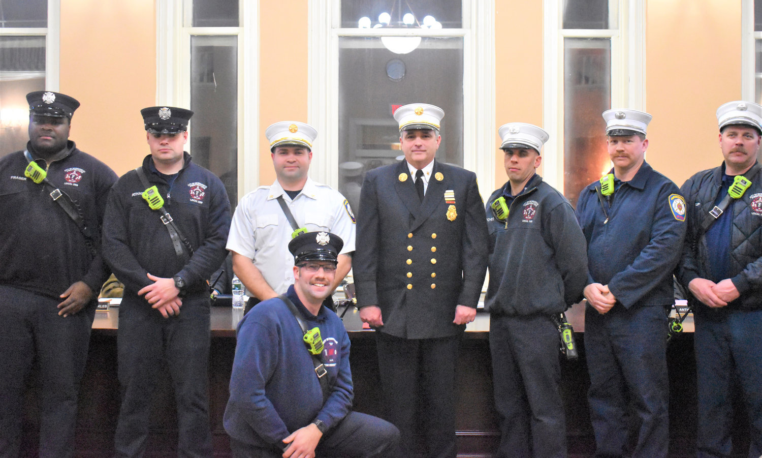 Chief William Horton [middle] poses with some of the City of Newburgh Fire Department.