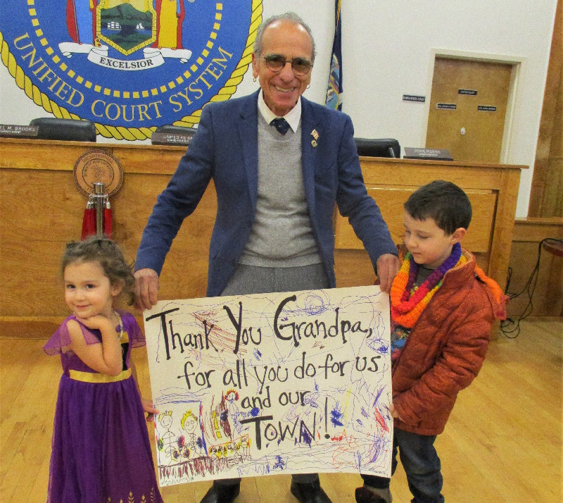 Supervisor Al Lanzetta receives a compliment from his grandchildren Josephine and Vincent DeBella.