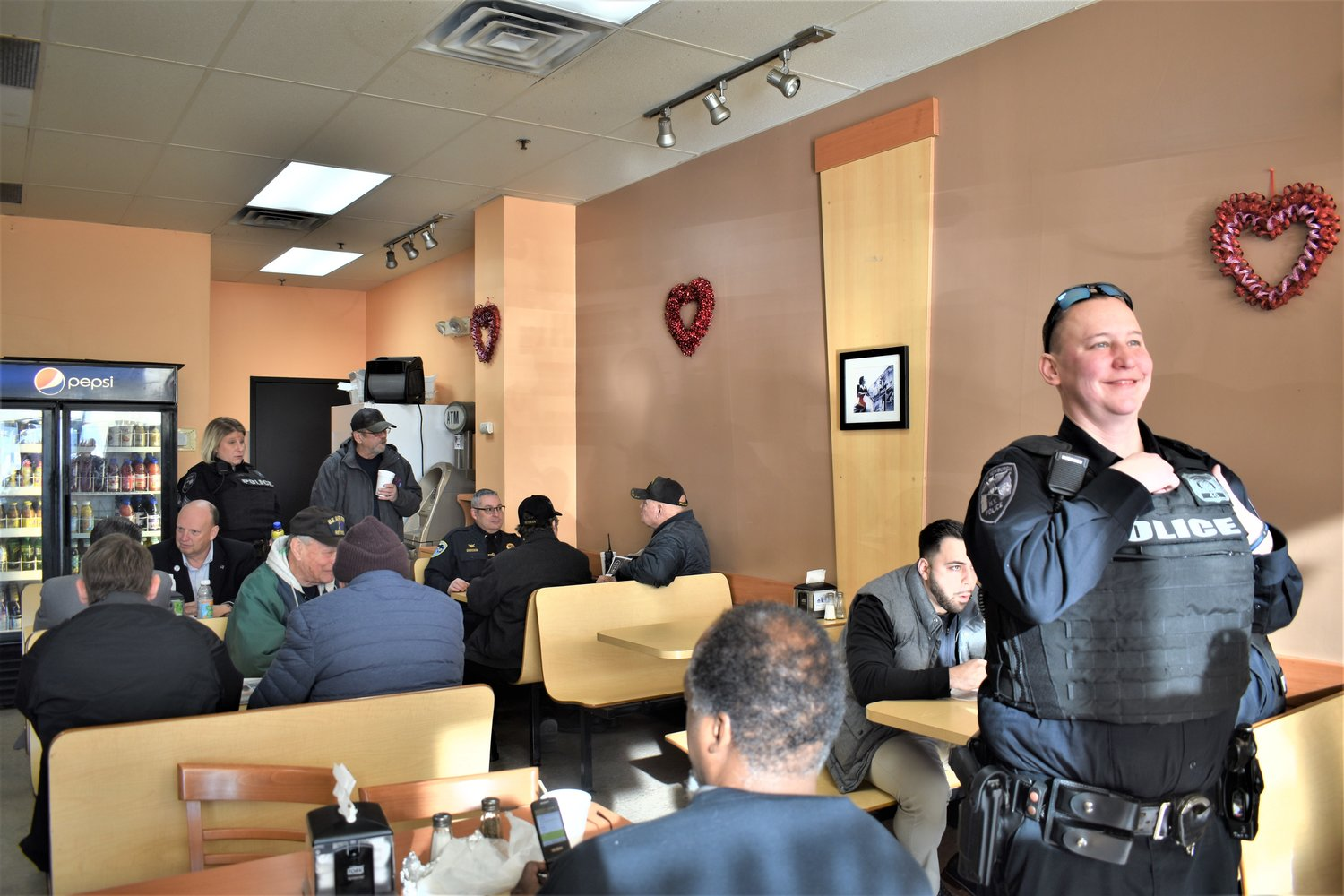 Officers and residents mingle during Coffee with a Cop on Thursday.