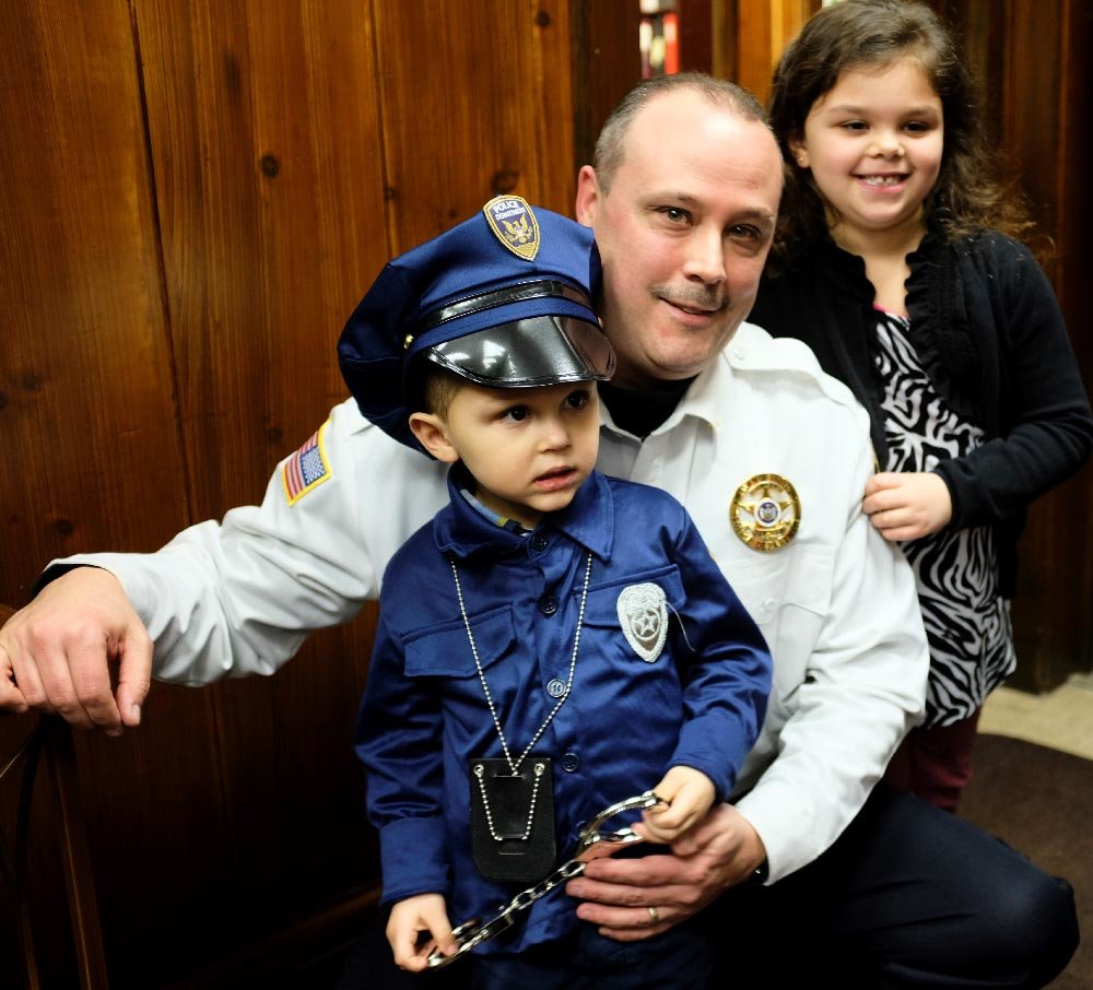 Chief James Janso posed with his children (future policeman) James and Giovanna after the ceremony.