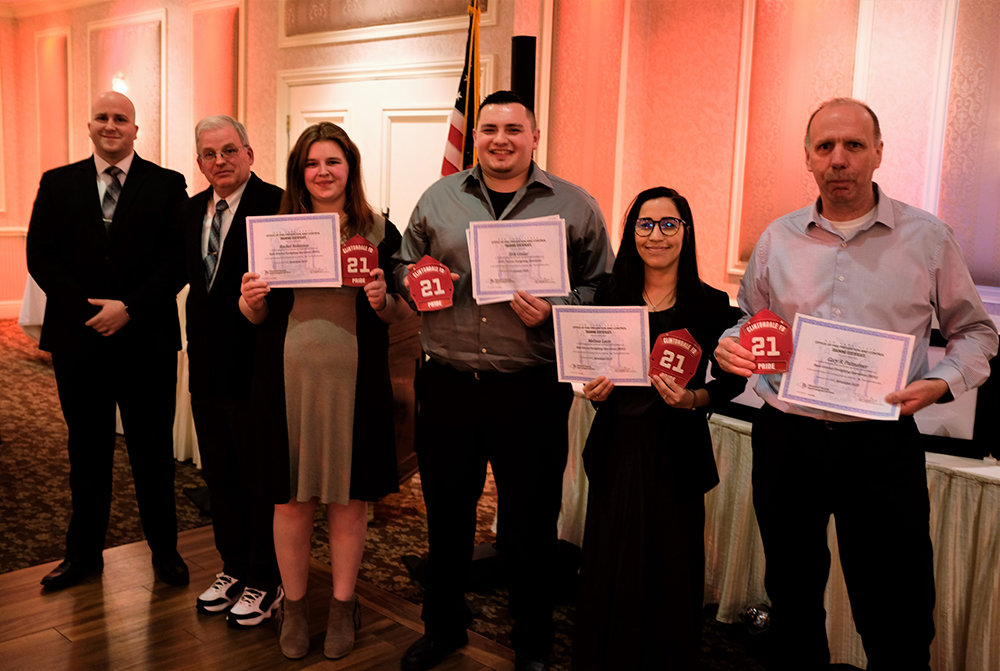 Red Shields were given to [L-R] Rachael Robinson, Erik Goslar, Melissa Leon and Gary Palmateer.