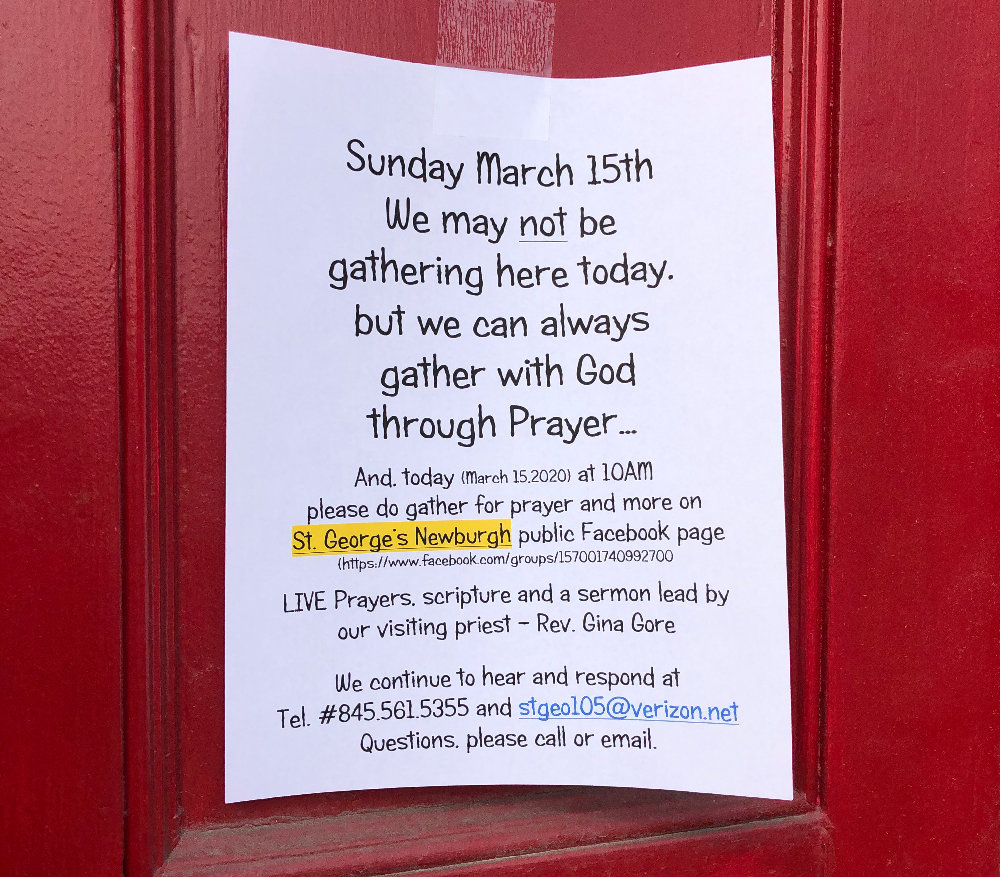 A sign on the door of St. George's Church notifies worshipers that Sunday Mass is canceled.