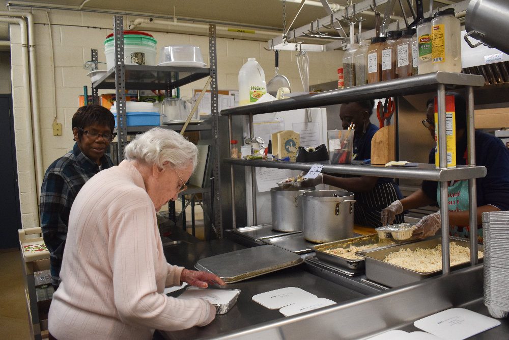 Meals on Wheels of Greater Newburgh kitchen staff work on preparing last Thursday's meals.