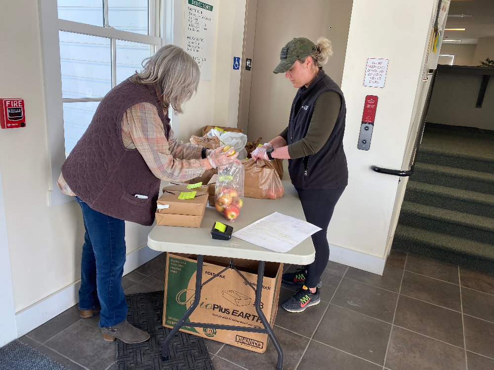 Gardiner Town Supervisor Marybeth Majestic (left) and Gardiner Deputy Town Clerk Julia Hansen (right) pack up food to be delivered to people in need in Gardiner, Shawangunk and Plattekill.
