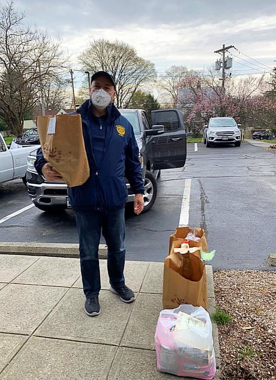 Scott Hamel Past President of Wallkill East Rotary seen here making a food delivery for Jewish Family Services to a family who is unable to venture out of their home.