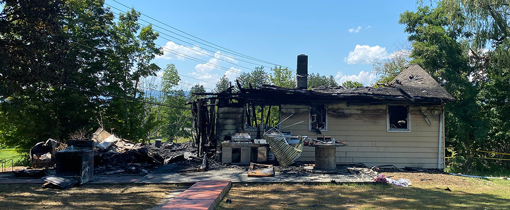 A fire set this house on 550 Burnt Meadows Road in Shawangunk ablaze early Sunday morning, claiming the lives of a father and his son.