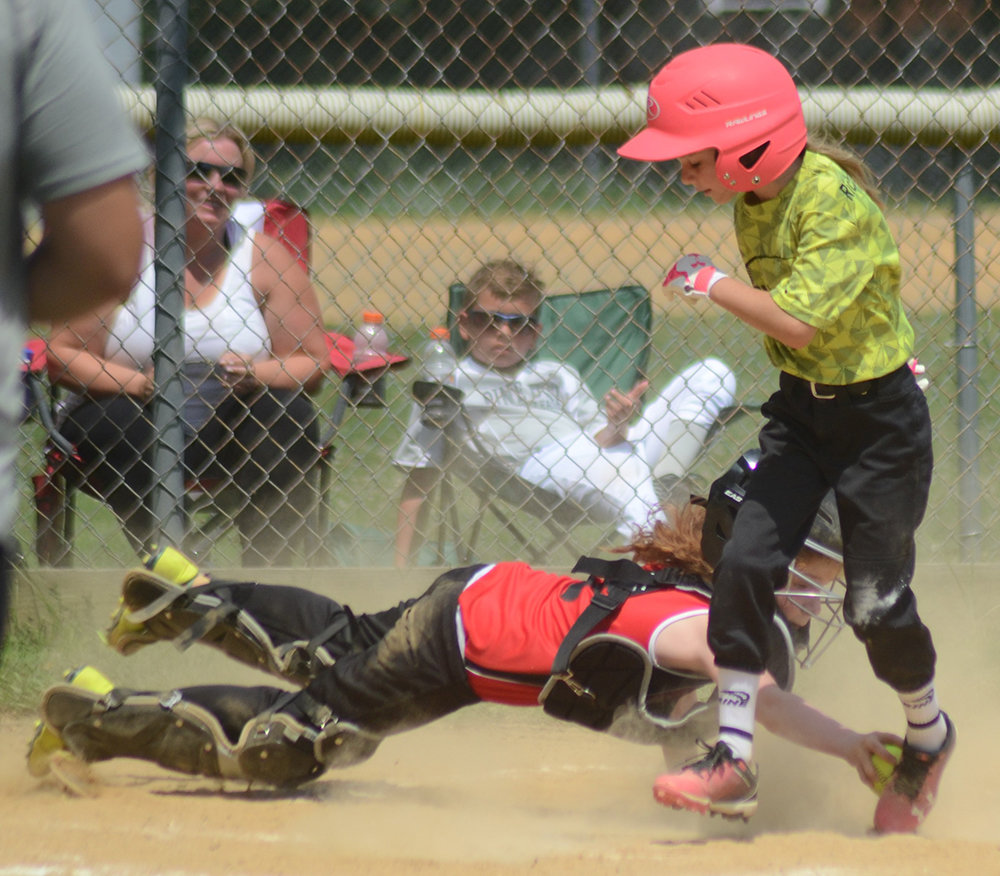 Montgomery's Devin Migliore scores a run ahead of the tag during a Little League softball game against the Pine Bush Falcons on Saturday.