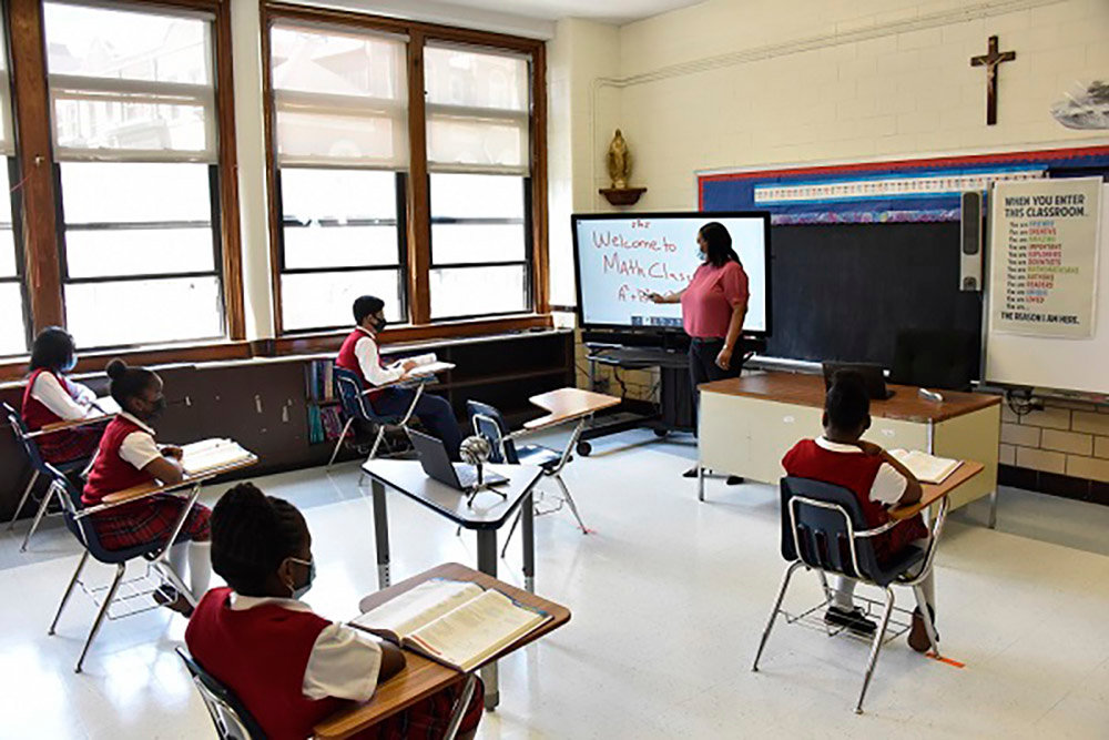 The Archdiocese of New York released photos showing daily screenings, daily cleaning of classrooms and social distancing instruction.