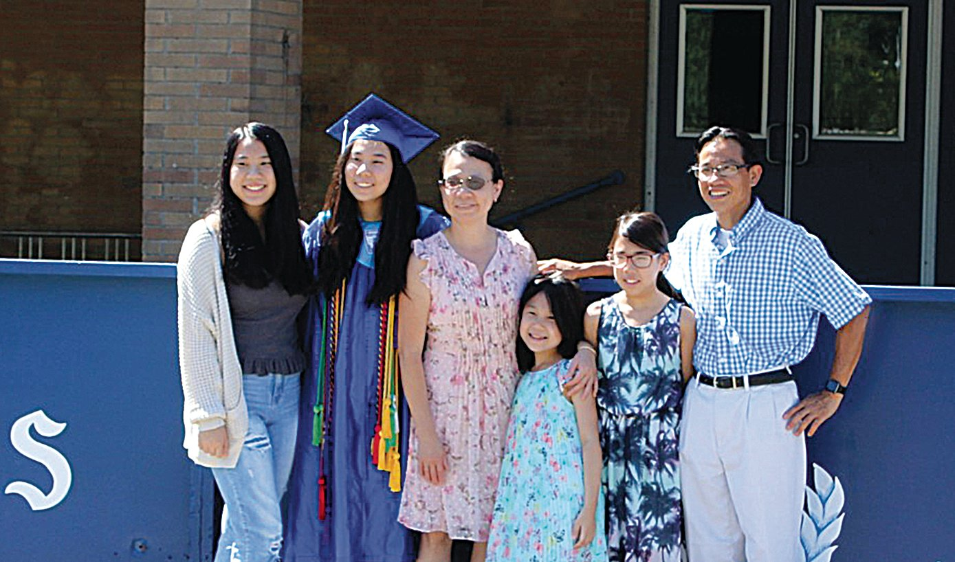 Class of 2020 Graduate Tam Vu poses with her family.