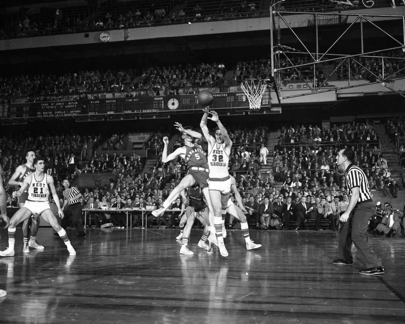 Seven years after a point-shaving scandal nearly-ruined the sport, Burkoski helped revive college basketball in New York, when the Jaspers upset top-ranked West Virginia in a NCAA  tournament game at Madison Square Garden.