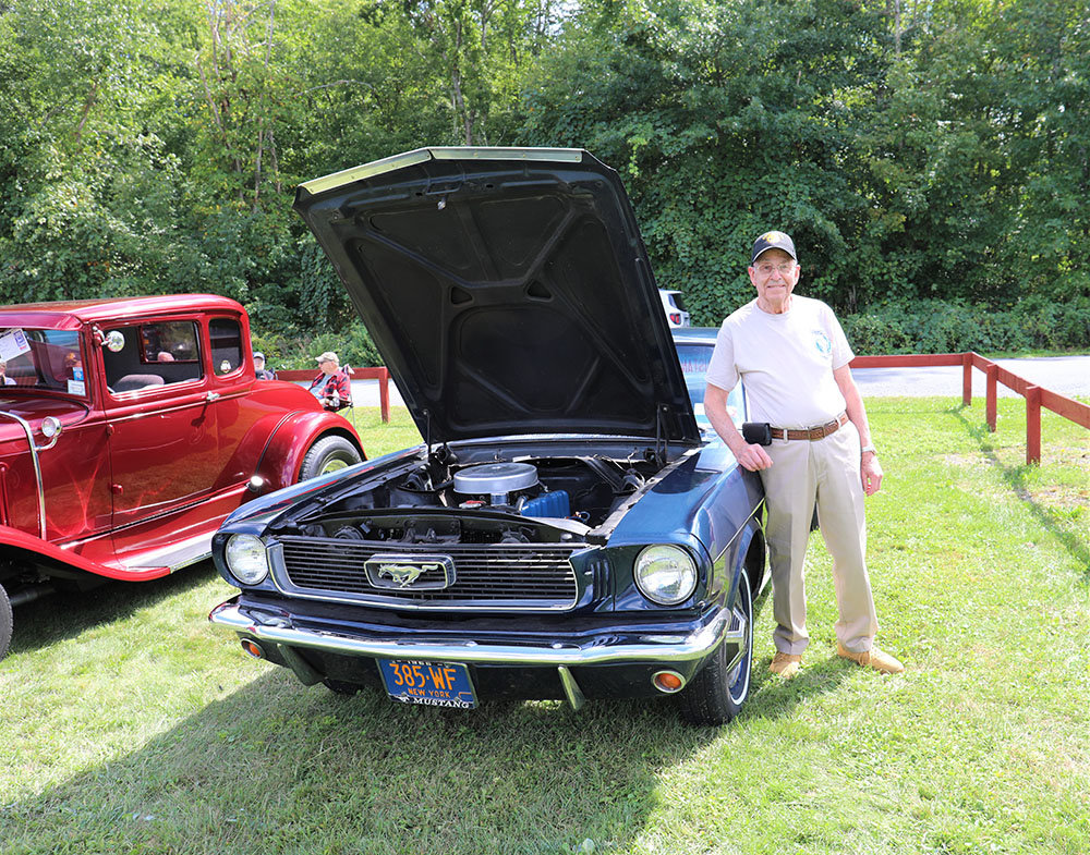 Fred Nelson alongside his 1965 Ford Mustang