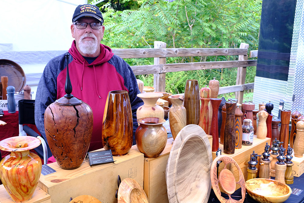 Douglas Scharf, of Knots In Your Head Woodworking Studio, shows off the many creative wood projects that he makes by hand on a lathe.