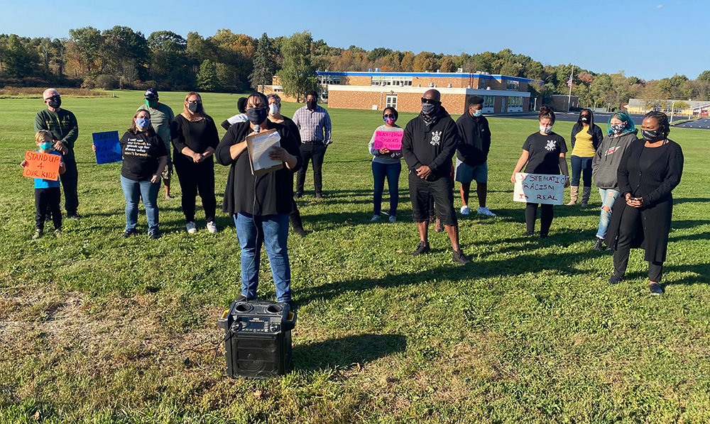 Lisa Ruiz, one of the founders of Valley Central Parents for Social Justice, speaks at their press conference in front of Berea Elementary School on Friday.