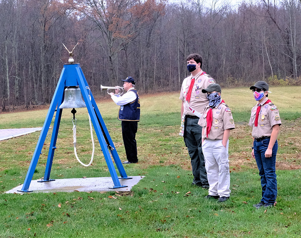 The Boy Scouts rang the bell twice, followed by the playing of Taps by Jim Farinelli.