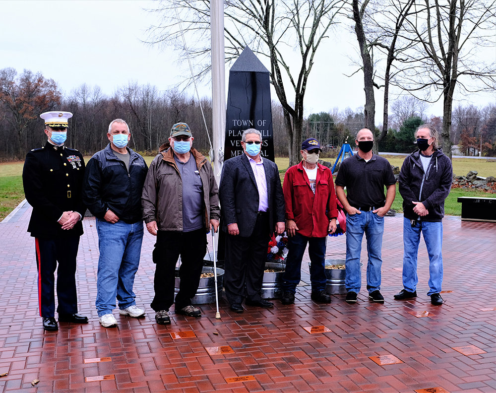 Representatives of the Town posed before the Veterans Memorial, [l – r.] Lt. Col. Stuart C. Smith, Town Councilmen Dean DePew and  Larry Farrelly, Supervisor Joe Croce, Councilman Mike Putnam and Darryl Matthews and Ulster County Legislator Kevin Roberts,