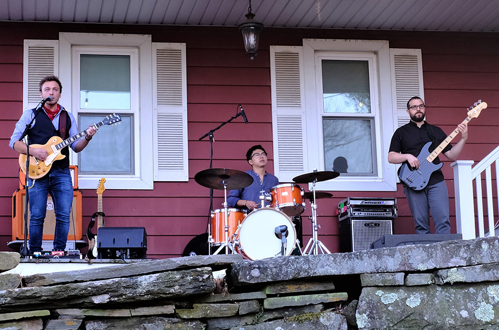Songwriter and guitarist Dylan Doyle [L] has been performing with drummer Mikiya Ito and bassist Ben Basile in a series of front porch concerts this summer for friends and neighbors.