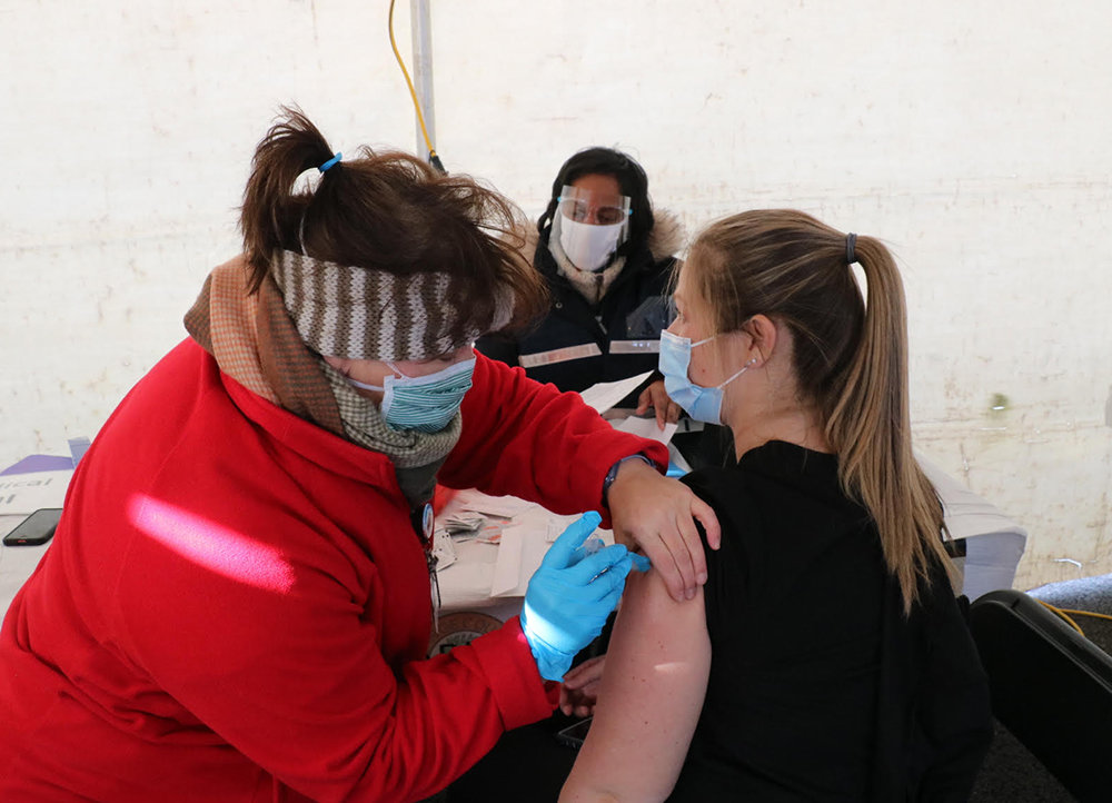 Mary Pat Bailey, a registered nurse with Horizon Family Medical Group, administers a vaccine to Dental Assistant Kristy Castro of Pine Bush.