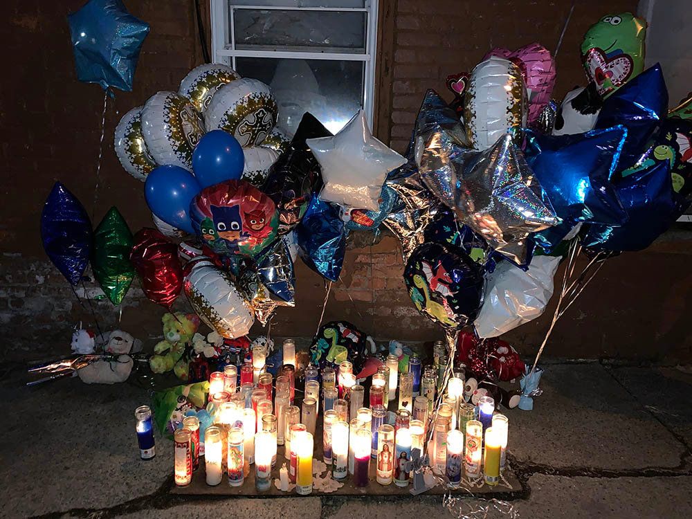 A vigil was held Sunday night outside 135 William Street, believed to be the boy's residence