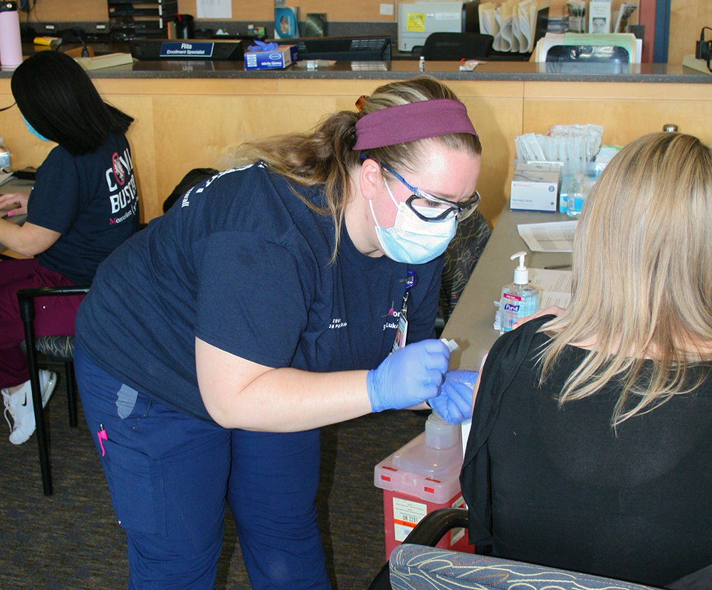SUNY Orange nursing student Tess MacLaren issues a COVID-19 vaccine during Friday's distribution on the College's Newburgh campus. It was expected that more than 1,000 area residents would be administered vaccines at a dispensing event jointly hosted by Orange County and Montefiore St. Luke's Cornwall Hospital.