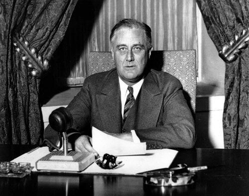 President Franklin D. Roosevelt prepares to begin his first fireside chat to the American people in this March 12, 1933,