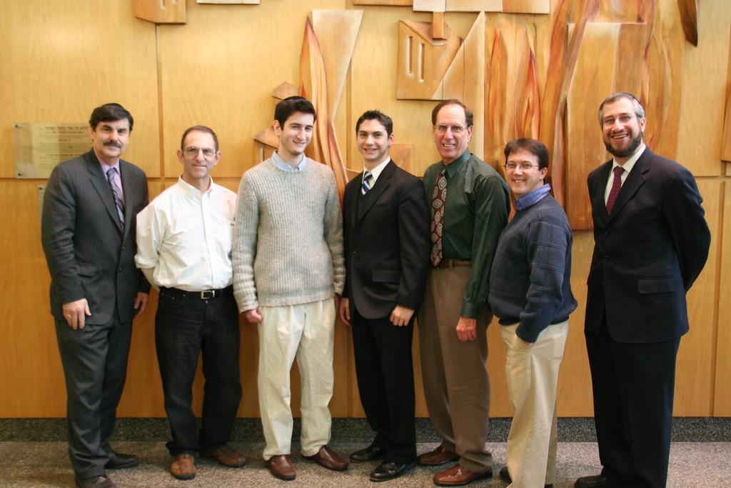 From left to right: Mr. Harvey Feldman, General Studies Principal, Dr. Robert Winston, Yonatan Edelstein,  Avi Moisa, Mr. Gerald Schmugar, Mr. Stephen Sullivan, Rabbi Yisroel Kaminetsky, Menahel