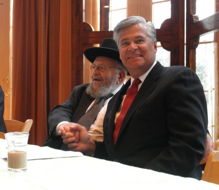 Senate Majority Leader Dean Skelos meets with Rabbi Binyamin Kamemetzky at a breakfast reception on March 6.
