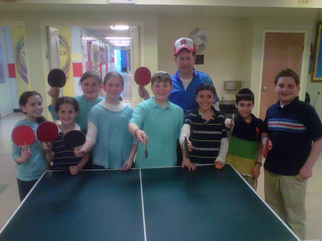 Jewish Table Tennis director Glenn Ackerman and Hebrew Academy of Nassau County participants.