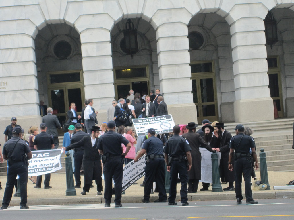 Anti-Israel Neturei Karta demonstrators stand outside the 2011 AIPAC convention in Washington