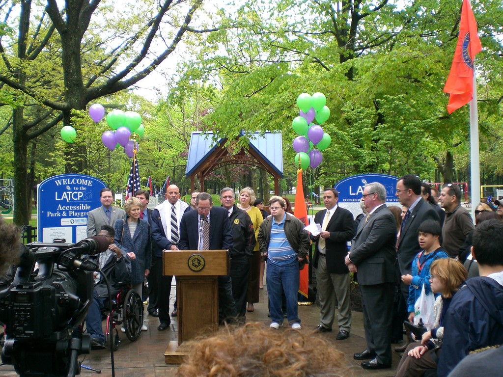 Nassau County Partners with Five Towns Businessmen taking the   initiative to Let All the Children Play   Nassau County Executive Edward P. Mangano and Adam Weingarten today joined Michael Alon of Lawrence, Chairman and Founder of Let All The Children Play (LATCP); David Weingarten, Vice Chairman of LATCP; Assemblymen Harvey Weisenberg, Tom McKevitt and Ed Ra; Nassau County Legislators Denise Ford, Rose Walker and Dave Denenberg at the Grand Opening of LATCP's highly anticipated fully accessible park and playground in Eisenhower Park, Field 4.  LATCP is a Long Island based not-for-profit organization dedicated to improving the lives and dignity of all children by developing accessible playgrounds and inclusive recreation programs.