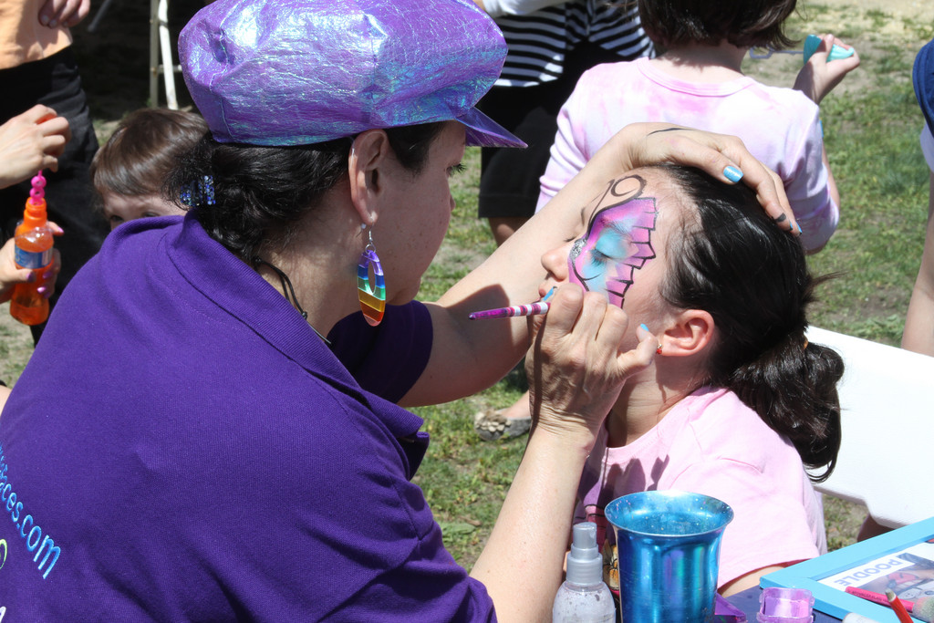 Kids, as well as adults enjoy face painting, rides, games, food, music and more at the fair.