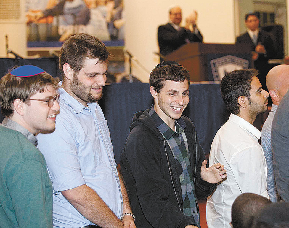 Gilad Shalit and members of his unit receive a standing ovation at Yeshiva   University