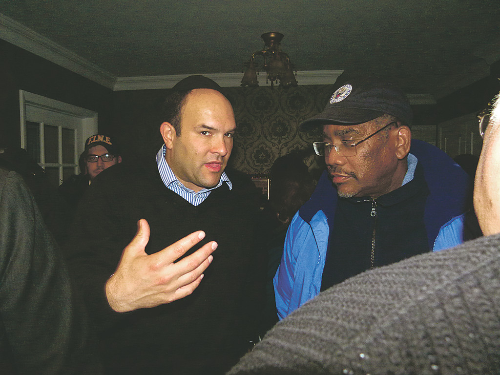 Michael Fragin discussing the damage to the community with Congressman Gregory Meeks following the aftermath of Hurricane Sandy.