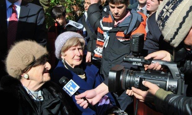 Two Holocaust survivors are interviewed by NY1 as Rambam students and others protest the continued residence of a 91-year-old Nazi in Jackson Heights.