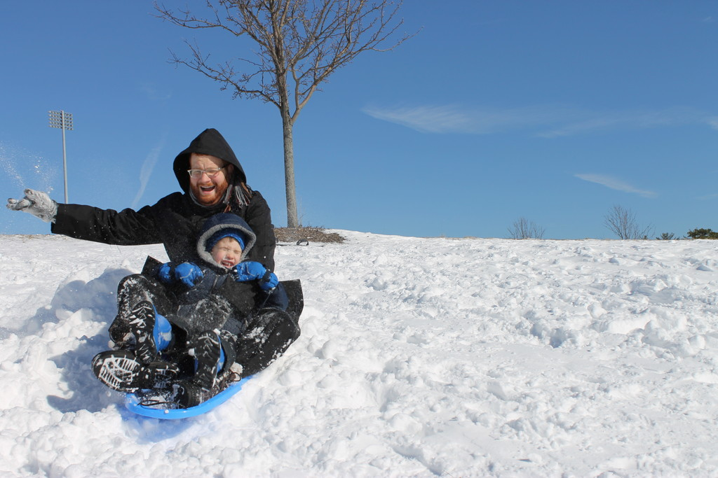 Father-son fun    From shoveling to snowboarding, snow days can be a family experience. Rabbi Abi Goldenberg, Rosh HaYeshiva at Nishmas HaTorah of Lawrence, rides with his son Yosef near his home in Lakewood after last Sunday